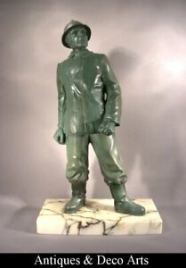 Fireman french patinated regulates h: 40cm on marble stand