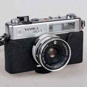 Macchina fotografica analogica Yashica MG-1 fotocamera a pellicola 35mm funziona