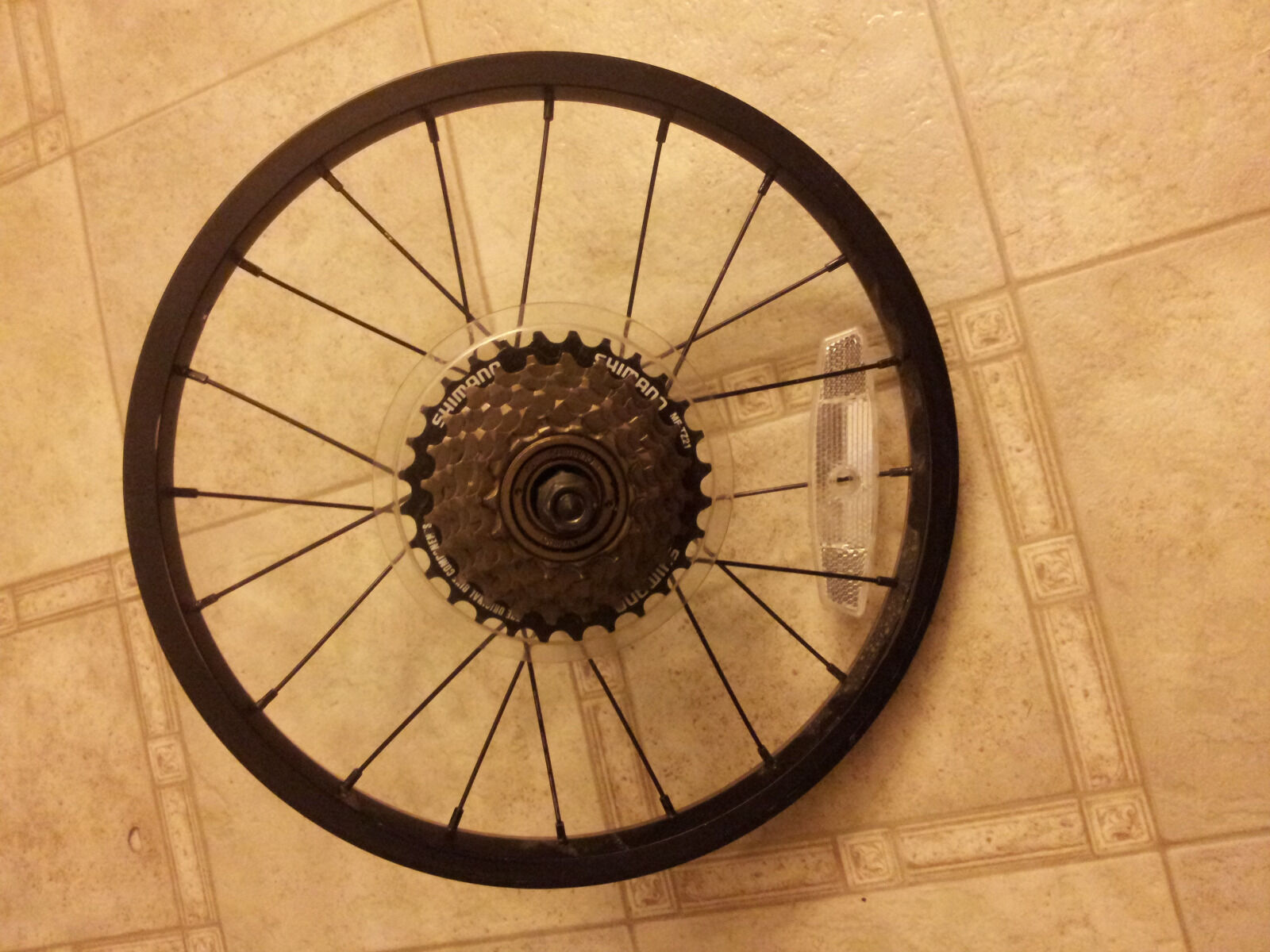 "Wheel 16"" with 7 speed cassette, shifter and derailleur   not to be missed!"