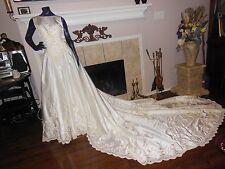 Beautiful MORI LEE white wedding dress with long train size 12