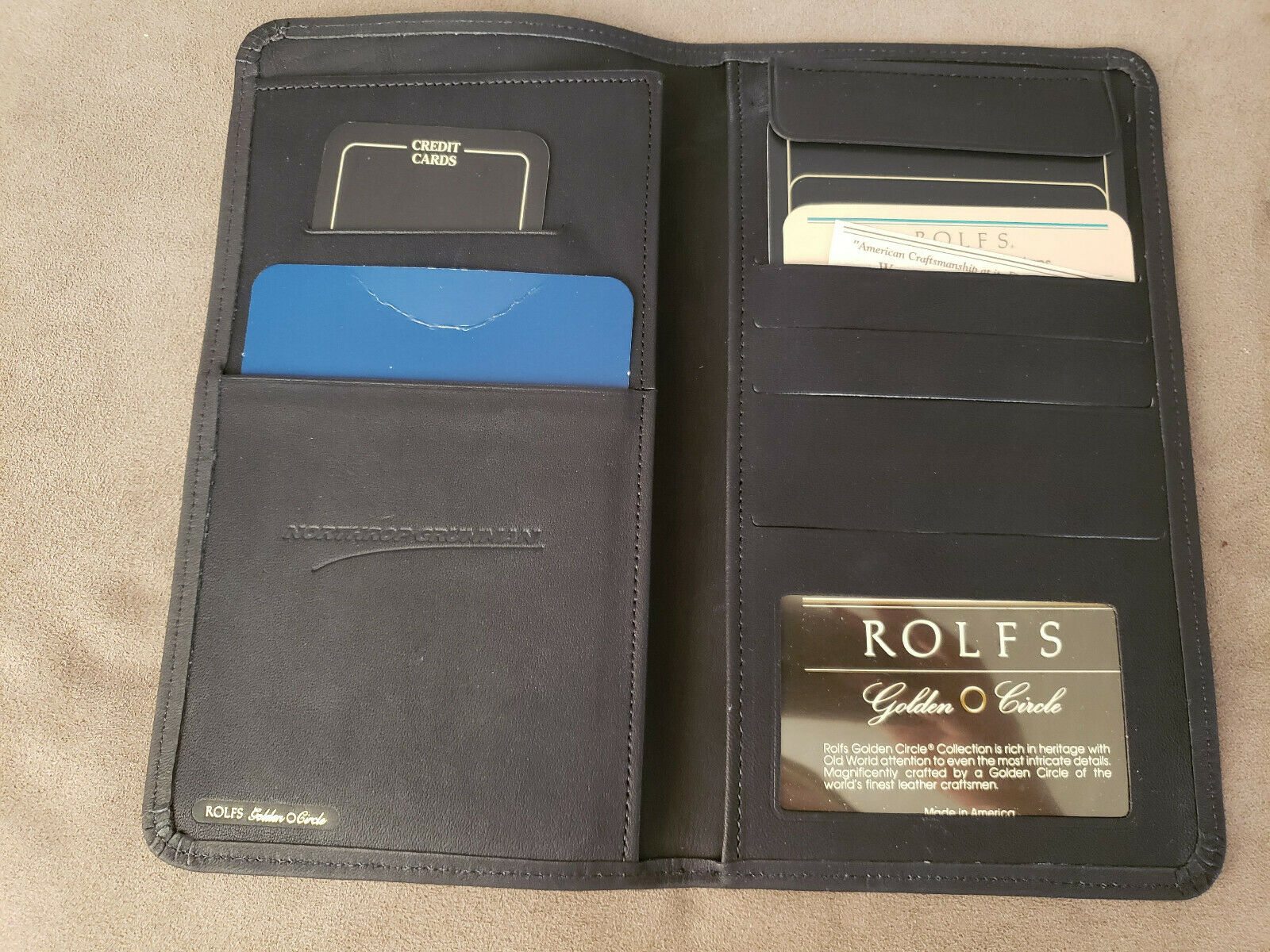 Black Rolfs Golden Circle Genuine Leather Travel Wallet. Brand new in box.