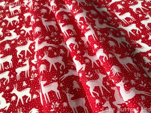LEAPING REINDEER CHRISTMAS FABRIC RED OR GREEN POLYCOTTON 112cm WIDE//METRE