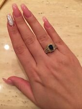 Wonderful 14k yellow gold natural emerald cut sapphire and baguette diamond ring