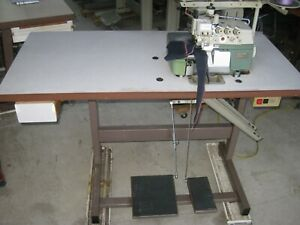 INDUSTRIAL 2 NEEDLE  PEGASUS E32 WITH 3/5 THREAD  OVER LOCKER SEWING MACHINE