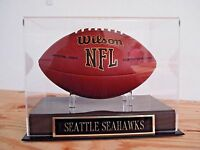 Football Display Case With A Seattle Seahawks Nameplate
