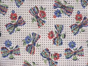 Vintage-Feed-Sack-Bowties-and-Daisies-Blue-Red-Green