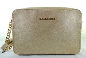 607a4708fd63 Michael Kors Jet Set Travel Large EW Pale Gold Leather Crossbody Bag ...