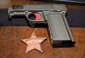"ROY ROGERS "" RIDERS "" SIGNAL GUN AND DEPUTY BADGE"