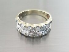 10 K Yellow Gold (3.3 Grams) .60 carats Baguette & Round Cut Diamonds Ring