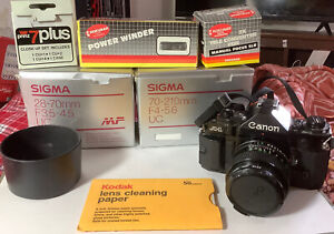 CANON A-1 FILM CAMERA 3 LENS Plus. In Original boxes/Manuals. Only Used Once.
