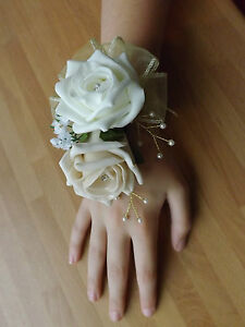 Wedding-flowers-bridesmaids-wrist-corsage-ivory-champagne-roses-diamante-pearls