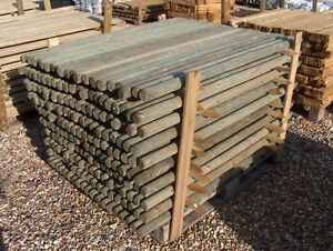 Details about 1 8m (6ft) x 50mm pressure treated round wooden fence posts -  just £2 99! wood