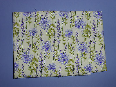 cotton poplin fat quarter with purple flowers and pale green leaves on cream