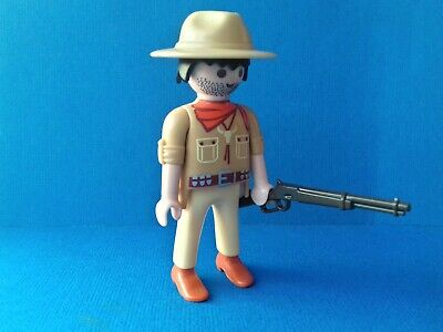PLAYMOBIL Western Un cow boy avec un chapeau texan noir et manteau gris