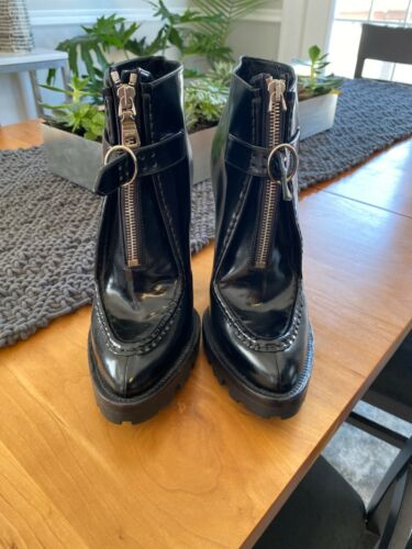 Prada woman  black lug sole boot 37
