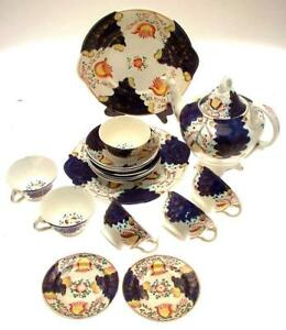 c1860-Gaudy-Welsh-teapot-cups-and-saucers-cake-plates-and-coasters-NEGR250