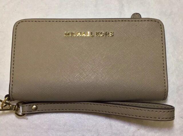 8bd988827c46 Michael Kors Jet Set Slim Tech Wristlet Dark Taupe Leather Women s Wallet  NWT