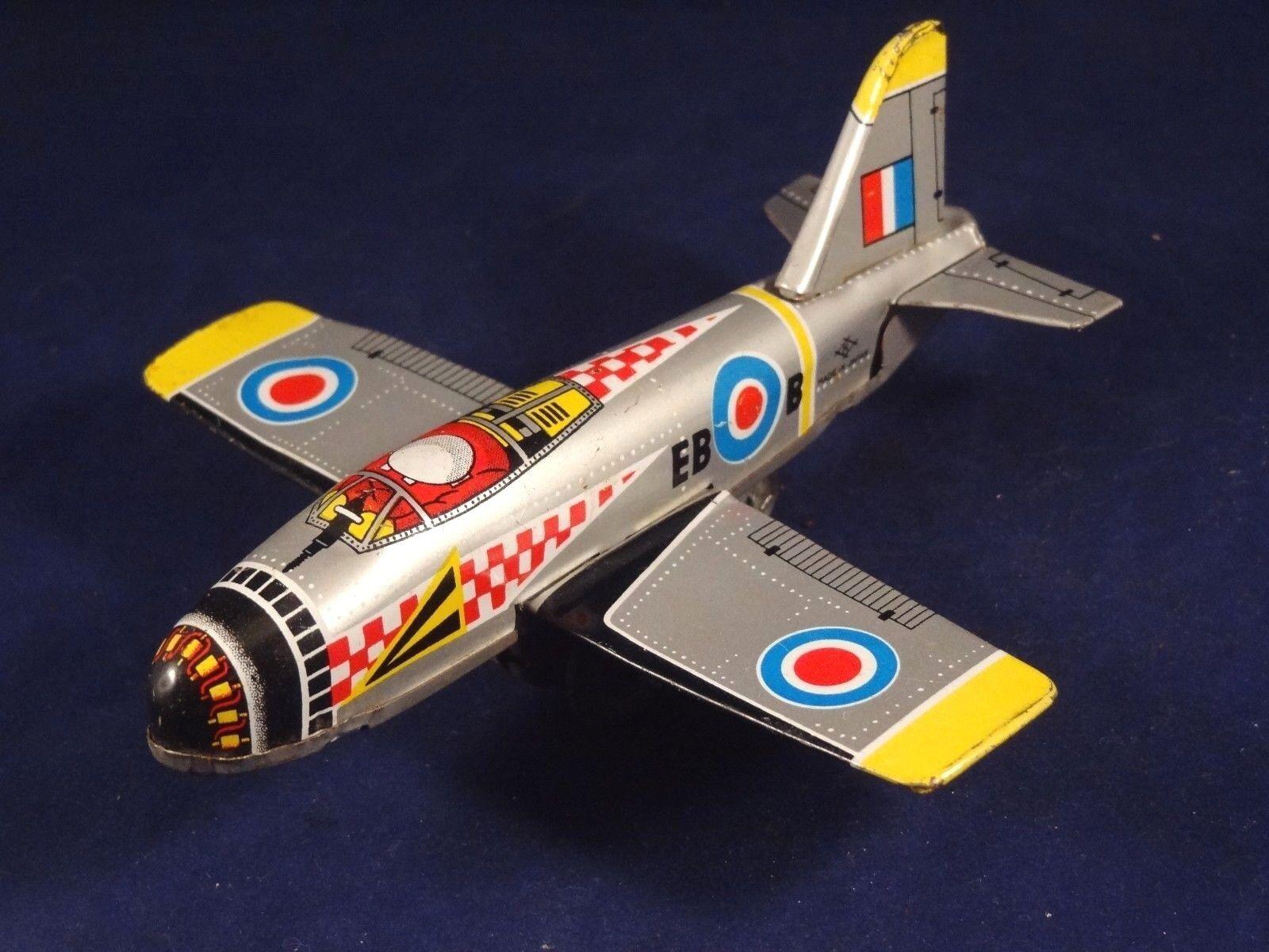 Ancien jouet avion de chasse K JAPAN Friction EBB tôle lithographiée 1960