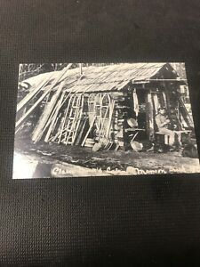 postcard-Manson-Creek-A-Miner-s-Cabin-With-Man-And-Dog-Pioneer-Card-Repro-I01