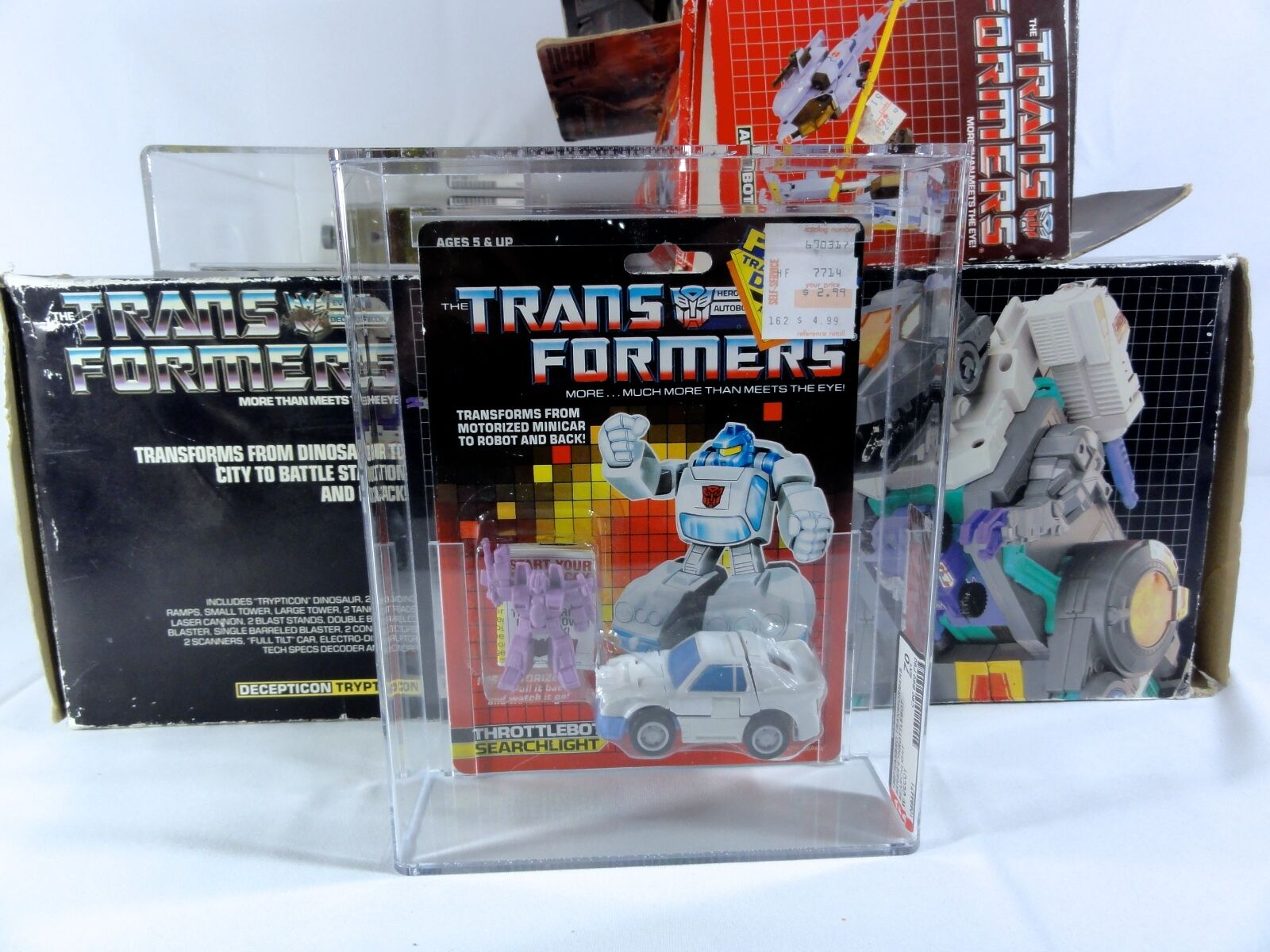 1987 Transformers AFA  Series 4 Throssotlebot Searchlight With Decoy MISB MIB scatola  prodotto di qualità