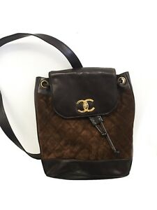 b6e47dcffd46 Image is loading Vintage-Chanel-mini-drawstring-backpack -brown-lambskin-leather-