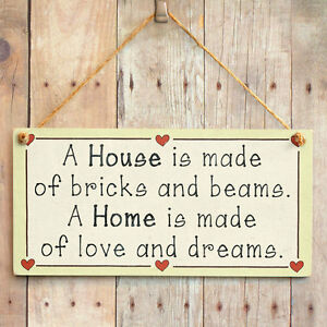 A-House-is-made-of-bricks-and-beams-A-Home-is-made-of-love-and-dreams-wood-sign