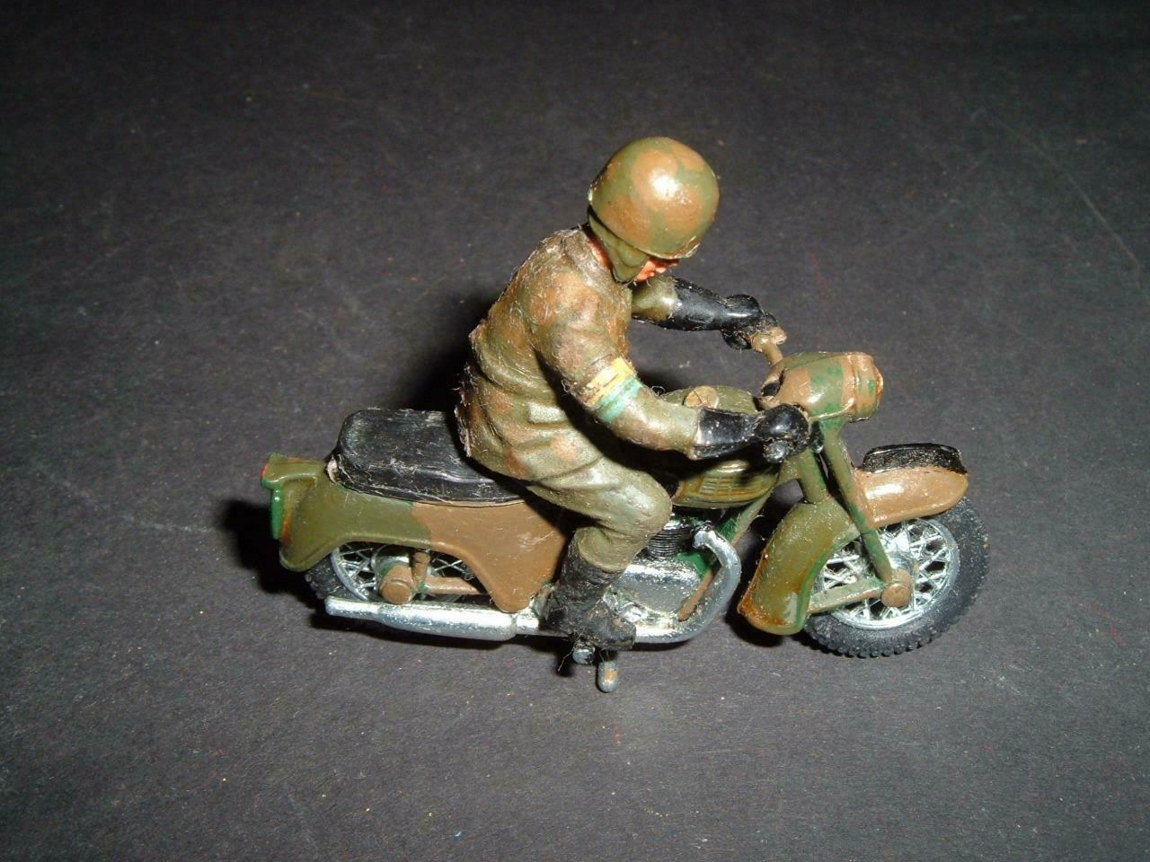 VINTAGE BRITAINS -  TRIUMPH MOTORBIKE - IN REPAINTED CON'D - IF NEEDED -