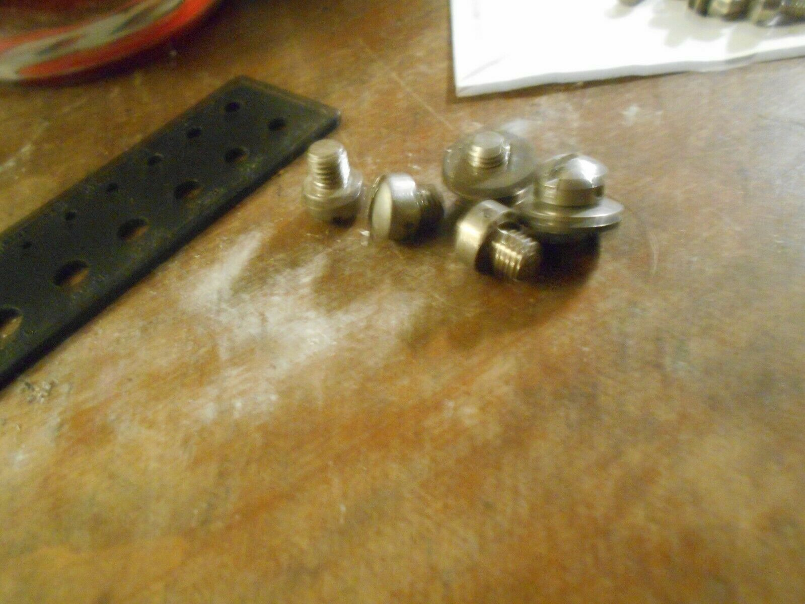 (1) sealable screw (sealed with a wire seal)