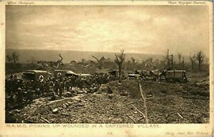 RAMC-picking-up-wounded-in-a-captured-village-antique-postcard-military