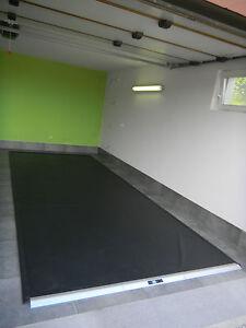 Garagenmatte-Garmat-HS-large-555-x-225-cm-Auspacken-Aufrollen-Drauffahren