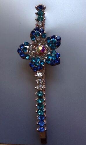 A Beautiful Metal And Blue Diamanté Flower Design Hair Grip