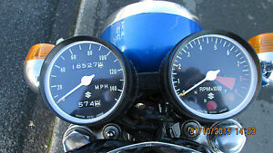 Suzuki-TS250-TS400-a-pair-of-new-Speedo-and-Tacho-outer-clock-bodies-SECONDS