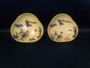 A pair of vintage hand painted white and blue Japanese porcelain bowls