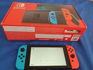 Nintendo Switch 32 Go Console Portable avec Manettes Joy-Con Bleu Néon/Rouge Né…