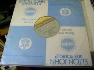 ELTON-JOHN-BITE-YOUR-LIP-GET-UP-AND-DANCE-KIKI-DEE-CHICAGO