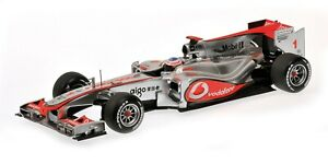 Minichamps-McLaren-MP4-25-2010-J-Button-1-18-scale-530-101801