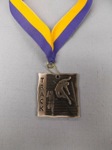 square silver medal track with blue/gold drape trophy award