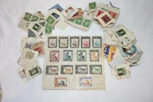 Large Assortment of US and mostly Foreign Uncancelled and Cancelled Stamps