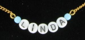 Linda-Name-Necklace-Gold-Tone-Blue-Glass-Circa-1950-60