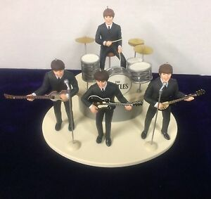 BEATLES-ED-SULLIVAN-FIGURE-SET-OF-4-WITH-INSTRUMENTS-ON-STAGE-NEW-IN-BOX-1994