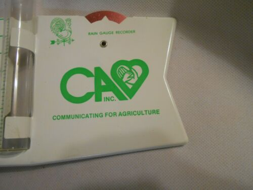 New old stock C A inc Agriculture with green rooster weathervane rain gauge