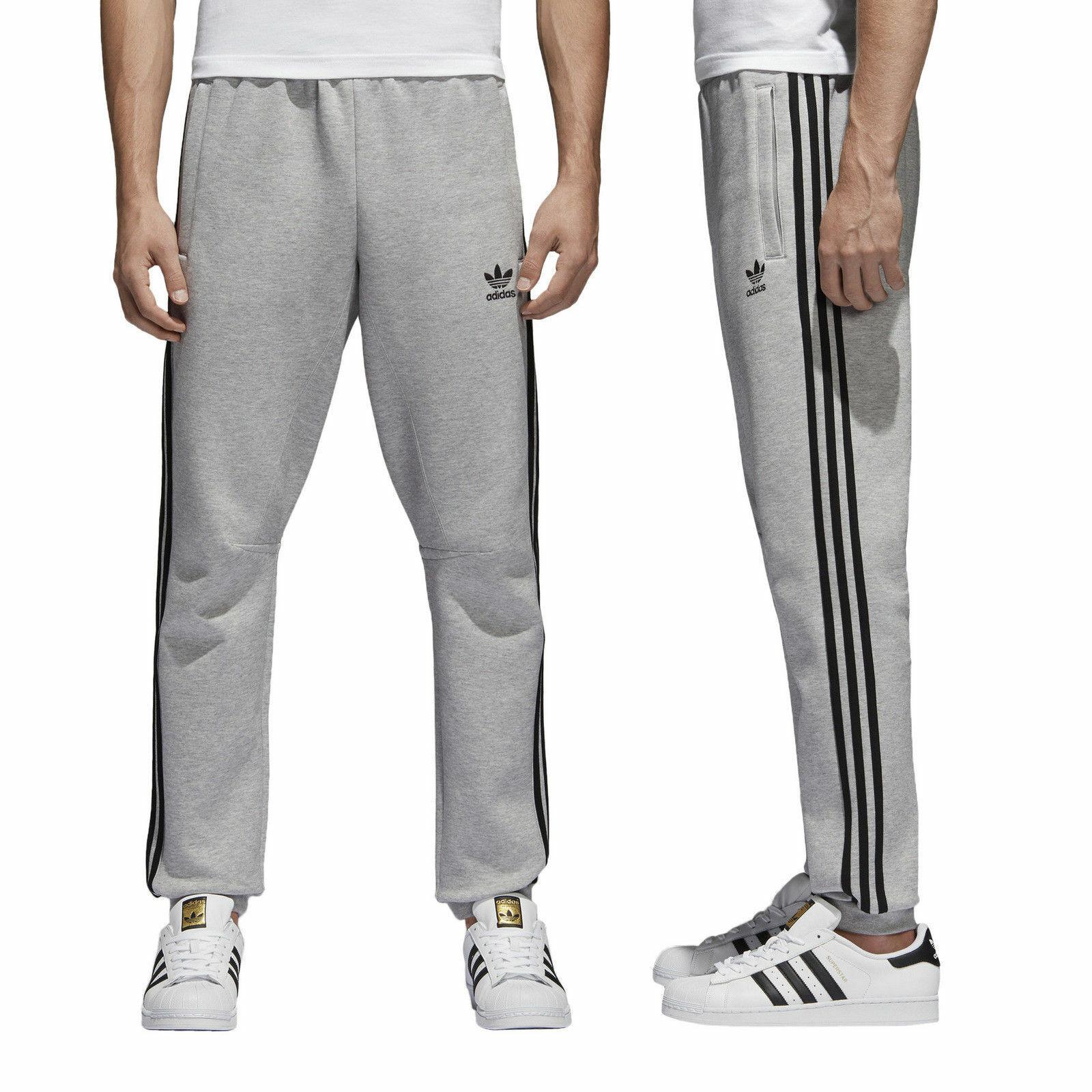 adidas – Originals adicolor – Jogginghose mit 3 Streifen in Blau, CW2430