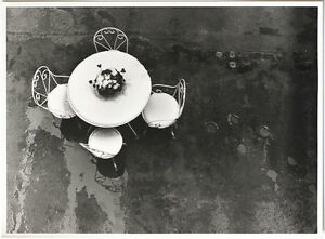 LG-VINT-1980s-white-table-against-dark-floor-still-life-by-Raoul-Bussy