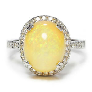 Oval-Opal-Halo-Ring-with-Diamonds-in-18kt-White-Gold-5-50ctw