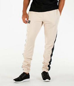 Under Armour Men s Sportstyle Stacked Terry Jogger Pants Beige ... f6cbab64fb6ce