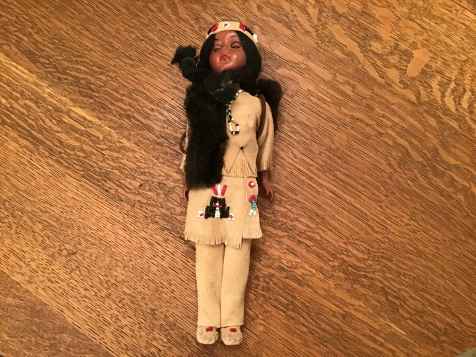 """Lot  1224.   Vintage 11.5"""" Tall Native American doll in leather and beaded"""