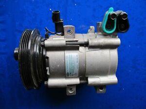 Klimakompressor  Kia Clarus 1,8i 16 V NEU original 0K9A161450