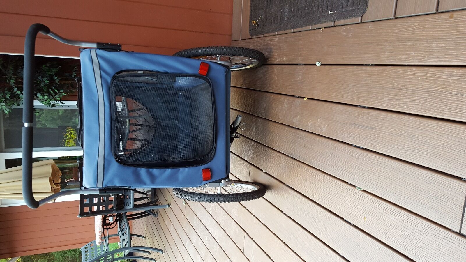 Carriage with zipper and extra wheel or bicycle attachment