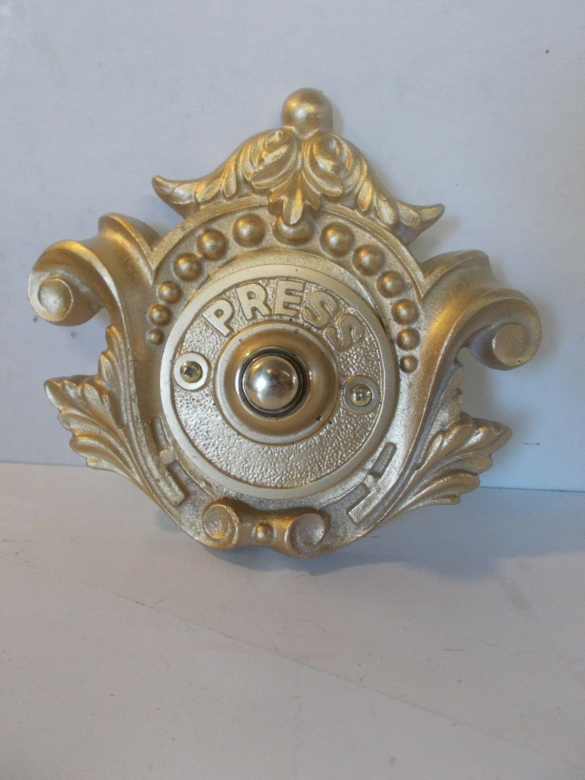Ornate Looking Wirot Door Push Bell Resin Gold In Colour