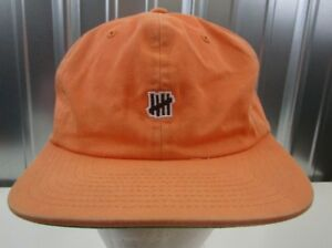 100% AUTHENTIC Undefeated UNDFTD Micro Icon Tally Logo Orange Strap ... 00f7eadbf4d